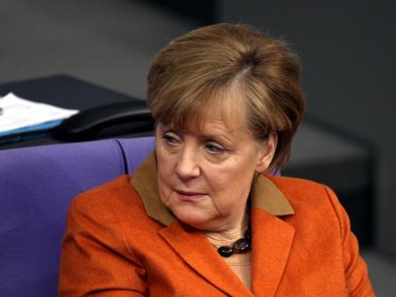Bild von Schweizer Bundespräsident trifft nach Volksentscheid Merkel