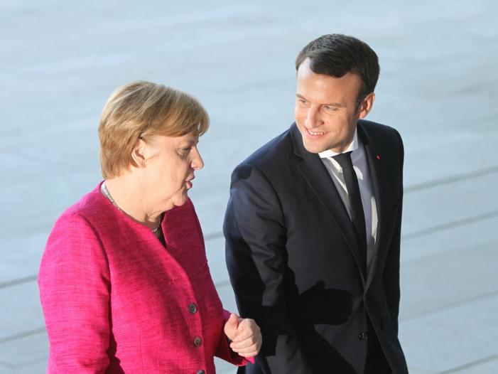 Merkel und Macron begrüßen Gefangenenaustausch in Ostukraine - Merkel und Macron begrüßen Gefangenenaustausch in Ostukraine
